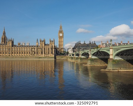 Houses of Parliament aka Westminster Palace and Westminster Bridge over River Thames in London, UK - stock photo