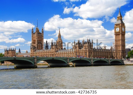 Houses of Parliament and a Westminster bridge at a sunny day - stock photo