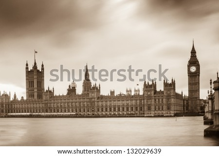 Houses of Parliament and Elizabeth Tower in London in sepia color style - stock photo