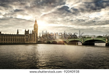 Houses of Parliament and Westminster bridge on a cloudy day - stock photo