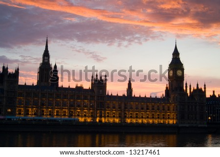 Houses of parliament at sunset, with moody orange clouds, London, UK