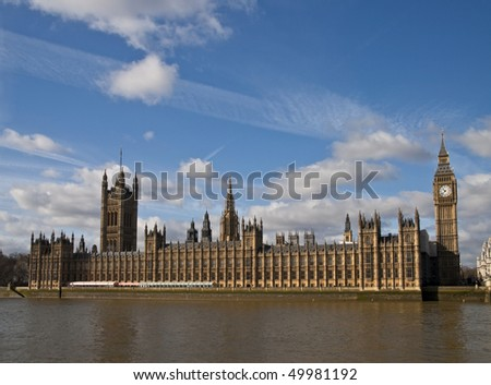 Houses of parliament on thames river - stock photo
