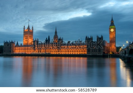 Houses of Parliament reflects in the Thames in London, UK - stock photo