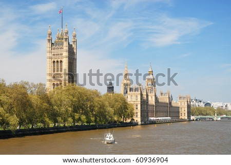 Houses of Parliament upon Thames River - stock photo