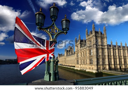 Houses of Parliament with flag of England, London, UK - stock photo