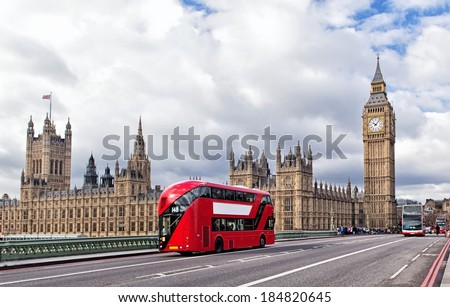 Houses of the British Parliament and red bus - stock photo