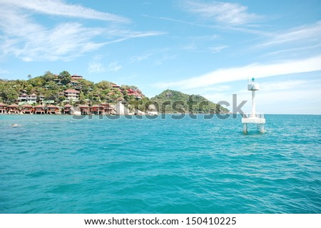 houses on an island in Thailand - an ocean view - stock photo