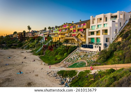 Houses on cliffs above Corona Del Mar State Beach, seen from Inspiration Point, in Corona del Mar, California. - stock photo