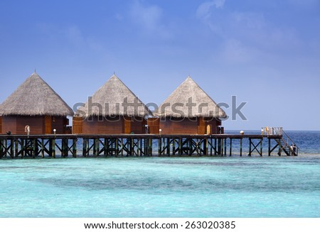 houses on piles on sea. Maldives. - stock photo