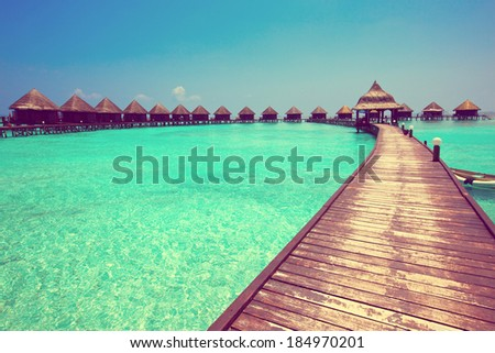 houses on piles on sea. Maldives.,with a retro effect - stock photo