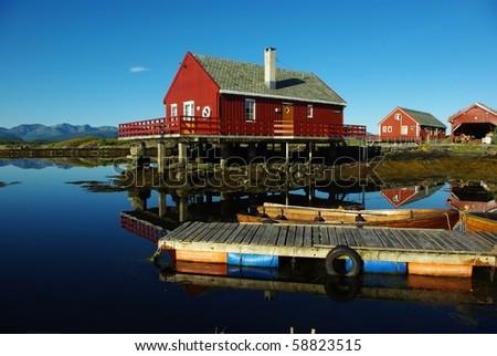 Houses on the sea coast and boats - stock photo
