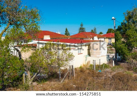Houses on the territory of the Robben Island, South Africa - stock photo
