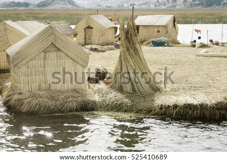 Houses on the  Uros Floating Islands made of tortora rushes. October 17, 2012 - Lake Titicaca, Peru.
