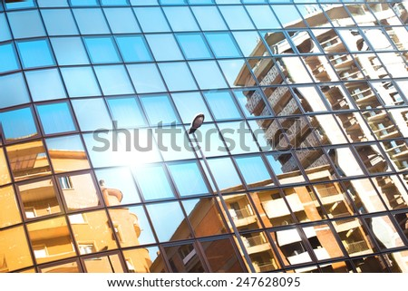 houses reflected by windows - stock photo