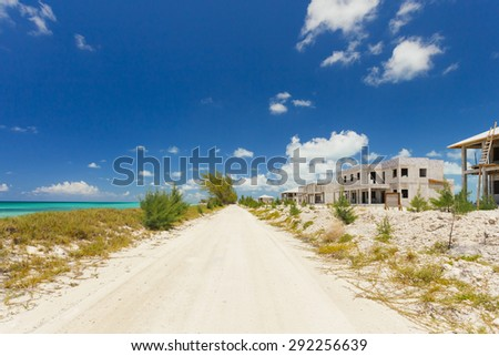 Houses under construction on tropical island. - stock photo