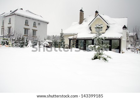 houses under snow - stock photo