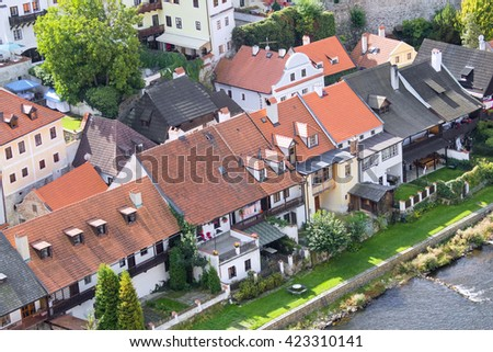 Houses with red tile roofs on the banks of the river channel in the beautiful old town