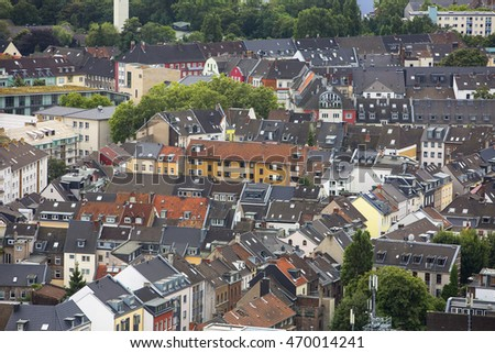 Houses with Skylights. Looking down on the jumble of houses with peaked roofs and skylights in Cologne in Germany.
