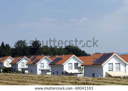 Houses with solar panels on roof - stock photo