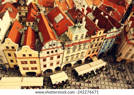 Houses with traditional red roofs in Old Town Square in Prague at sunset. Czech Republic        - stock photo