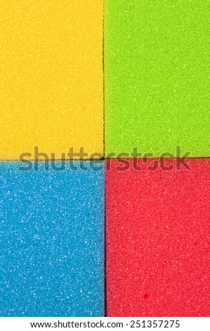 Houseware Concept. Closeup of Four Colorful Kitchen Sponges. Vertical Image Composition - stock photo