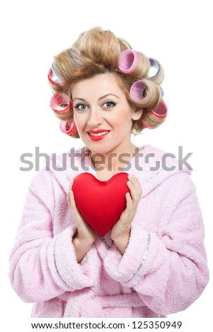 Housewife and heartshape pad on white background - stock photo
