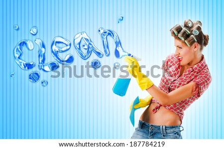 Housewife cleaning with spray, blue background