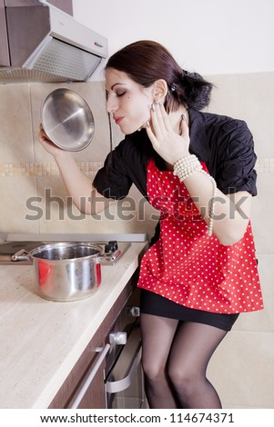 Housewife cooking in the kitchen - stock photo