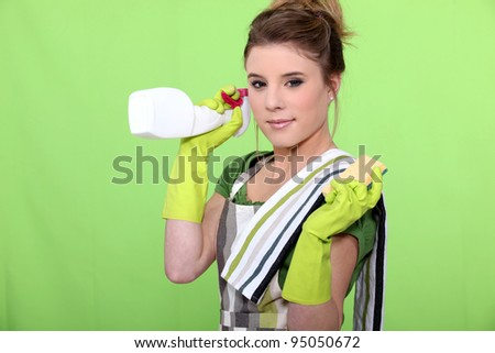 housewife holding a sponge and a product - stock photo