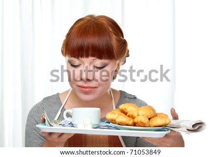 housewife holding tray with breakfast over white