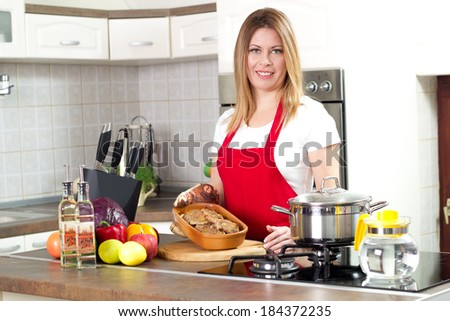 housewife in red aprons ready to serve meal