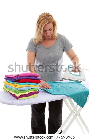 housewife is doing the ironing over white background - stock photo