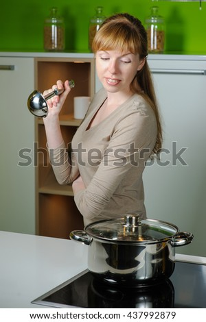 housewife looking in to pan
