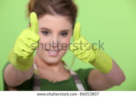 housewife making a thumbs up sign - stock photo