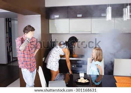 Housewife overlooked roast chicken in the oven, stylish people, hipsters - stock photo