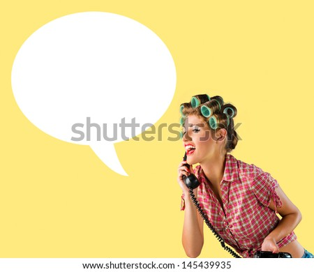 Housewife talking on the phone,yellow background - stock photo