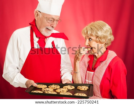 Housewife tastes the cookies at a bakery to see if they are as good as her own homemade.