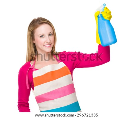 Housewife using the bottle spray