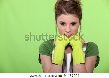 housewife wearing gloves - stock photo