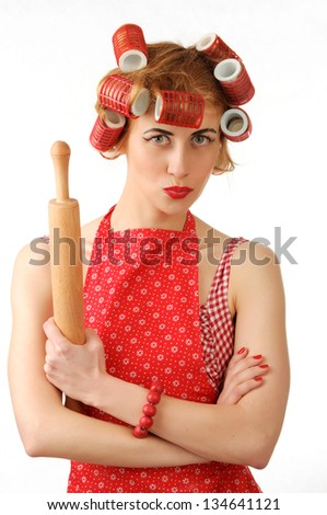 housewife with a rolling pin on white background
