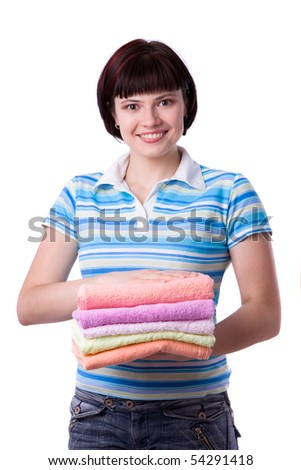 Housewife with clean laundry.  A young woman holding clean towels. Time for laundry day. - stock photo