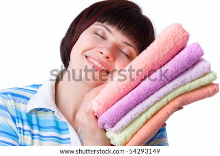 Housewife with clean laundry.  A young woman holding clean towels. Time for laundry day.