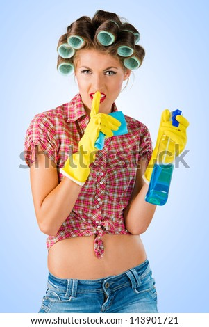 Housewife with cleaning product - stock photo