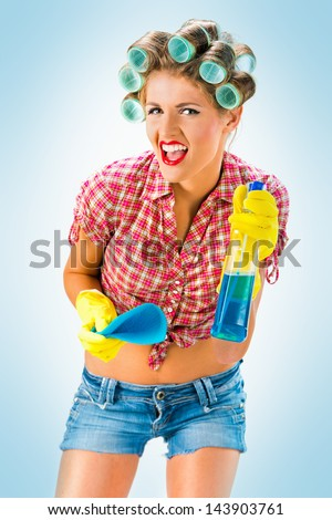 Housewife with cleaning product, blue background