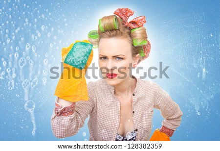 housewife with scubberr cleaning window / glass . Foam / soap on glass - stock photo