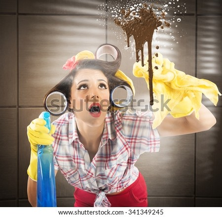 Housewife with spray cleaning a dirty glass - stock photo
