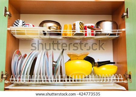 Housework, hygiene and cleaning concept. Dirt at home. Dirty filthy drainer with clean dishes in kitchen. - stock photo