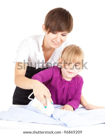 housework - young mother ironing with little daughter - stock photo