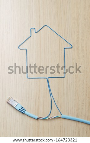 Housing concept. Green ethernet cable shaping a house