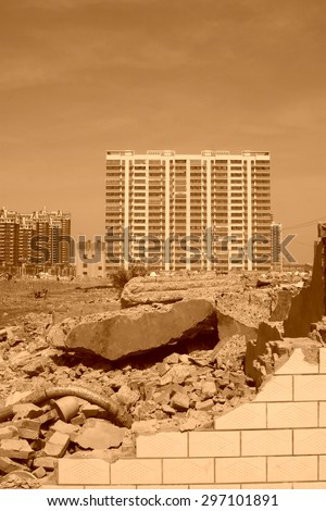 Housing demolition materials in the demolition site and new building, April 6, 2014, Luannan county, hebei province, China.    - stock photo